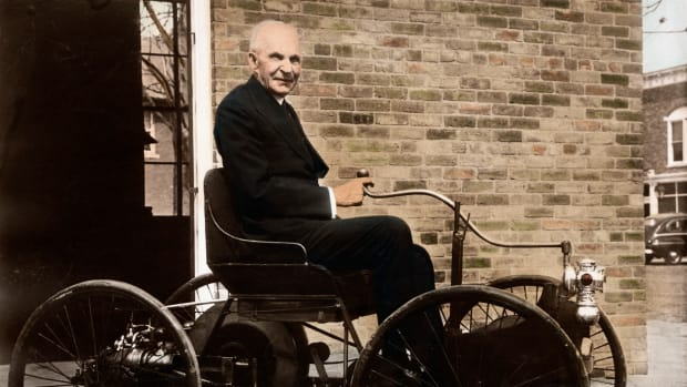 1946, Dearborn, Michigan, USA — Henry Ford sits in his old pride and joy, the 1896 Quadricycle, outside his shop on Bagley Avenue in Dearborn, Michigan. — Image by © Bettmann/CORBIS