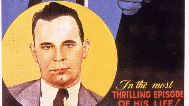 Film poster showing an illustration of American gangster John Dillinger (1902 – 1934) to advertise a short newsreel film called 'Dillinger: Public Enemy No. 1,' 1934. (Hulton Archive/Getty Images)