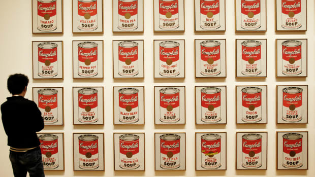 visitor-looking-at-campbells-soup-cans-by-andy-warhol-museum-of-modern-art-new-york-city-usa