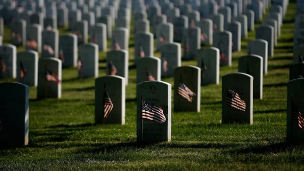 flags-are-placed-at-arlington-national-cemetery-graves