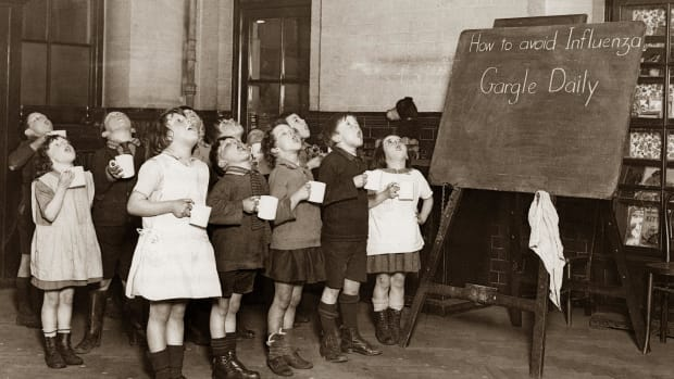 little-schoolchildren-gargling-their-throats-as-a-precaution-against-the-influenza-epidemic-england-photograph-around-1935