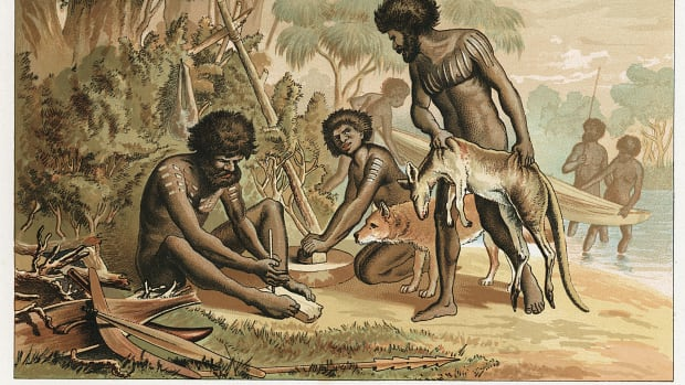 australian-natives-preparing-meal-from-animal-they-have-hunted