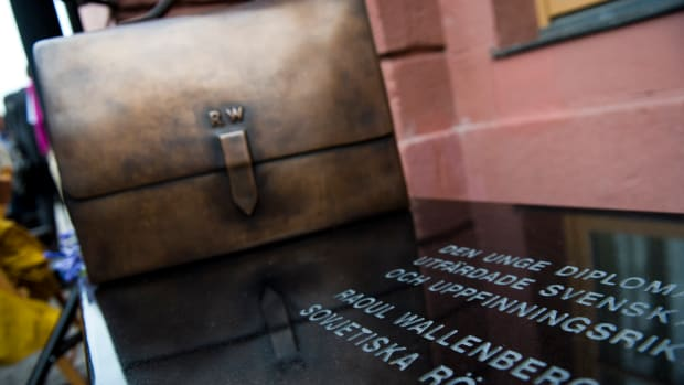 A new memorial to Raoul Wallenberg stands outside the Ministry for Foreign Affairs in Stockholm on August 16, 2012. The memorial consists of a bench made of black diabase with a briefcase of bronze placed diagonally on top. The briefcase has a text about Raoul Wallenberg engraved on its side.AFP PHOTO/JONATHAN NACKSTRAND        (Photo credit should read JONATHAN NACKSTRAND/AFP/GettyImages)