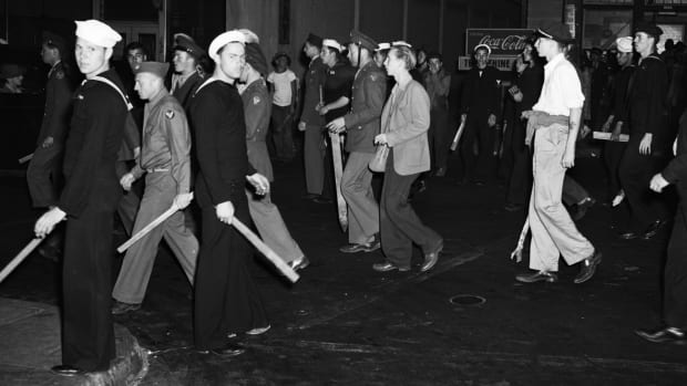 Armed with clubs, pipes and bottles, this self-appointed posse of uniformed men was all set to settle the Zoot Suit War when the Navy Shore Patrol stepped in and broke it up.