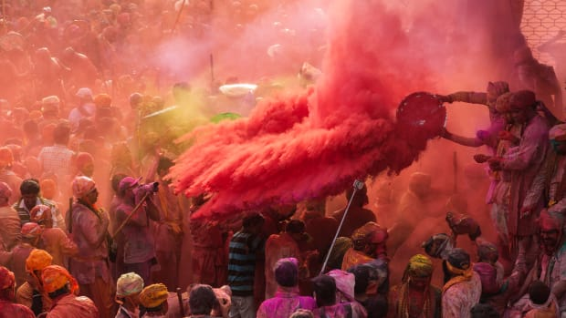 young-men-from-the-neighbouring-town-of-barsana-celebrate-holi-with-coloured-water-and-gulal-powder
