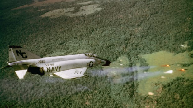 07 Sep 1966, South Vietnam — South Vietnam: U.S. Navy rockets flash from beneath the wings of a  during an attack on a Viet Cong position. This F-4B is part of a VF-96 flying from the USS Enterprise>. — Image by © Bettmann/CORBIS