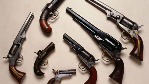 "Variety of Civil War handguns including, a Bacon Pocket Revolver, an Evans derringer sits to the right with Sharps four-barrel "" pepperbox"" beneath. Top is a real Pepperbox, and to the right is a Colt 1849 Pocket Revolver and to its right is an 1865 Remington New Model Army Revolver. To the far right is a Model Colt .36 navy Revolver. — Image by © Tria Giovan/CORBIS"