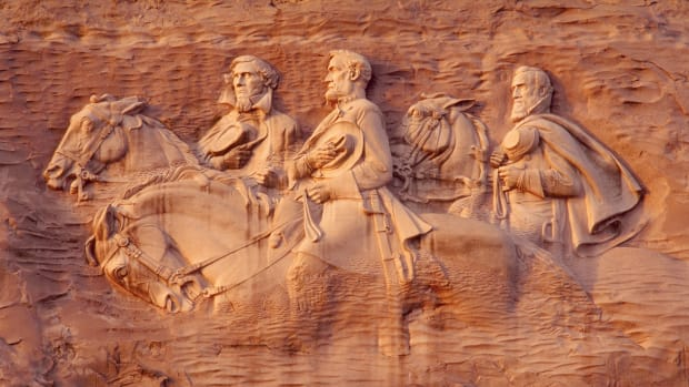 "1923-1970 — Bas-relief sculpture of three of the leaders of the Confederacy on horseback: President Jefferson Davis, General Robert E. Lee and General Thomas ""Stonewall"" Jackson. Their likenesses are carved onto the side of Stone Mountain, the largest granite outcropping on earth. — Image by © Kevin Fleming/CORBIS"