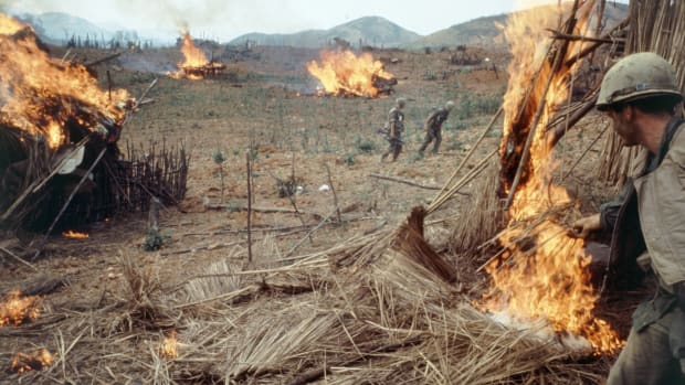 Subject: US Army burning vietnamese huts during Operation Pegasus. Khesanh, Vietnam 1968 photographer- Larry Burrows Time Inc Owned merlin- 1201698