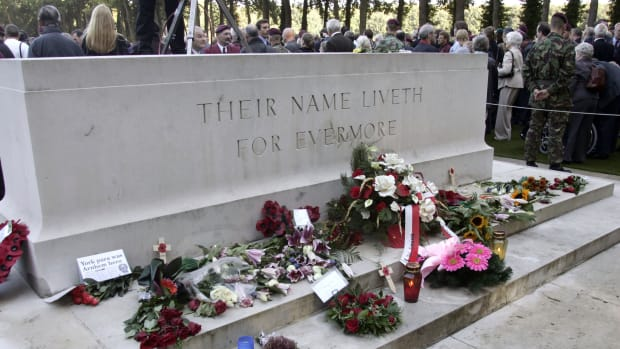 OOSTERBEEK, NETHERLANDS – SEPTEMBER 19:  Flowers and wreaths lie on a memorial stone at the 60th commemoration service of the allied Operation Market Garden or the Battle of Arnhem which liberated The Netherlands from the German forces at the Airborne Cemetery September 19, 2004 in Oosterbeek, The Netherlands.  (Photo by Michel Porro/Getty Images)