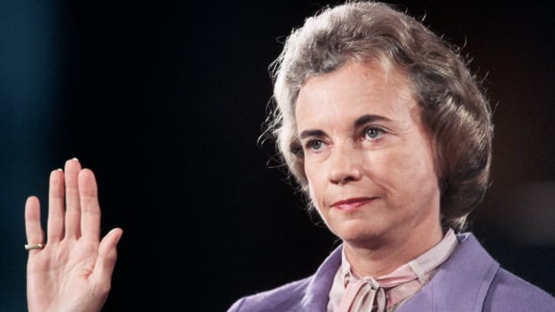 ca. 1981, Washington, DC, USA — Sandra Day O'Connor Being Sworn In — Image by © Wally McNamee/CORBIS