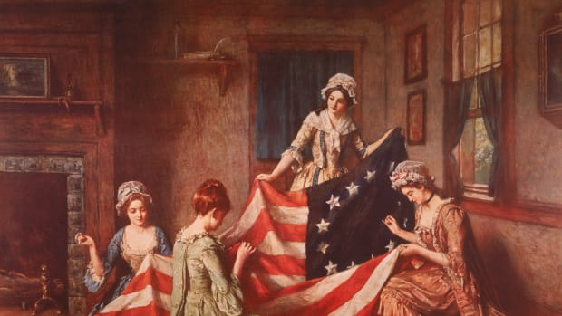 Painting depicts Betsy Ross and her assistants sewing the first American flag, Philadelphia, Pennsylvania, 1877. Painting by Lambert/Getty Images)