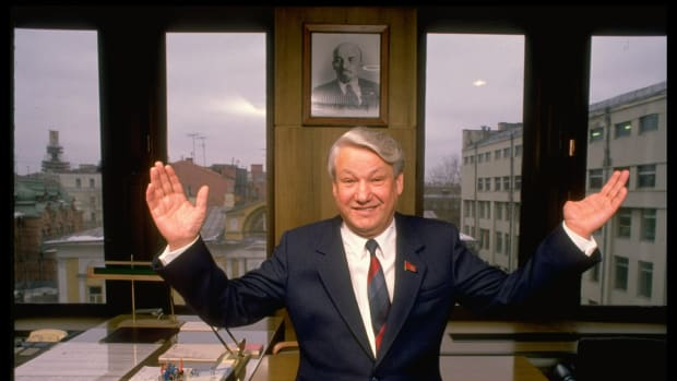 Maverick Russian politico Boris Yeltsin striking jocular, out-flung arms stance (during TIME interview), in his Lenin portraited Min. of Construction office.  (Photo by Ted Thai//Time Life Pictures/Getty Images)