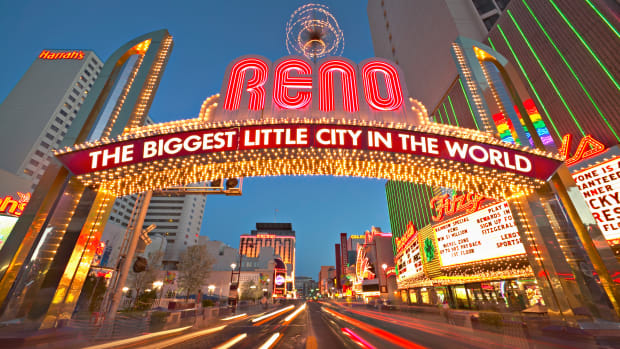 "March 2004, Reno, Nevada, USA — A huge neon sign on an arch declares Reno to be ""the biggest little city in the world."" — Image by © Owaki – Kulla/CORBIS"