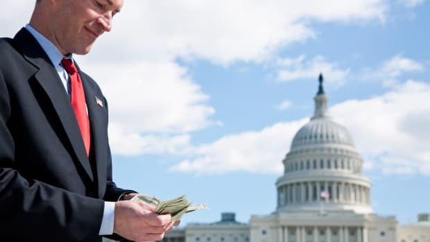 a-politician-counting-money-in-front-of-the-us-capitol-building