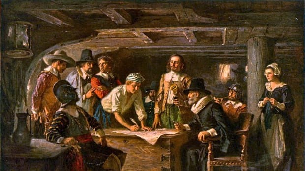 "A reproduction of an oil painting from the series ""The Pageant of a Nation"" by Jean Leon Gerome Ferris, depicting passengers of the Mayflower—including John Carver, John Alden, Myles Standish, John Howland, William Bradford, John Allerton and Samuel Fuller—signing the Mayflower Compact."