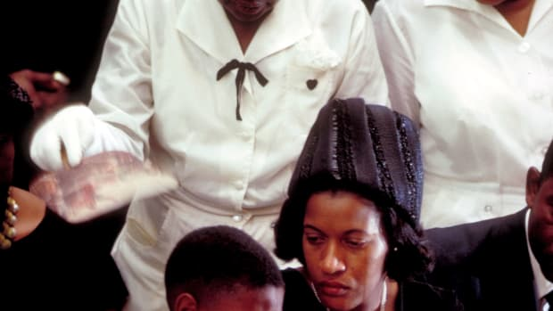 (front-R) comforting son Darryl Kenyatta during funeral of her husband, civil rights activist Medgar Evers (who was murdered by Byron de La Beckwith), Jackson, Mississippi, June 18, 1963. (Photo by John Loengard/Time Life Pictures/Getty Images)