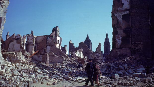 Date taken: 8/1944 Description: Locals walking through ruins of the heavily bombed city of St. Lo. City: St. Lo Country: France cr: Frank Scherschel/Time & Life Pictures/Getty Images OWNED