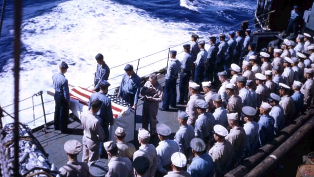 High-angle view of a burial at sea ceremonies aboard the USS Hansford (APA-106) during the invasion of Iwo Jima, February 1945. (Photo by PhotoQuest/Getty Images)