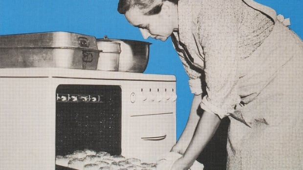 Rural Electrification Program poster featuring a woman sliding baked rolls out of an oven, 1940s. (Credit: Found Image Holdings/Corbis via Getty Images)