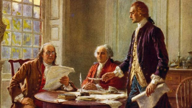 Benjamin Franklin and John Adams meeting with Thomas Jefferson, standing, to study a draft of the Declaration of Independence.