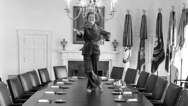 Betty Ford dancing on the Cabinet Room table