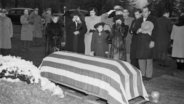 The body of Felix Longoria, a Texas GI of Mexican descent whose family found trouble in paying him final honor in his home town, was buried today in Arlington National Cemetery. Longoria, 26-year-old Mexican-American from Three Rivers, TX, was killed in action in the Philippines. Left to right: Mrs. Guadelupe Longoria, mother; Mrs. Sara Marino, sister-in-law; Adelita the soldier's 8-year-old daughter; Corporate I. Wait, Army ceremonial aide and Mrs. Beatriz Longoria, his widow.