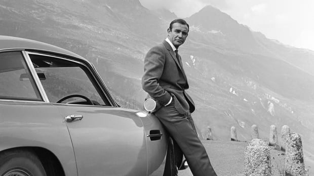 1964: Actor Sean Connery poses as James Bond next to his Aston Martin DB5 in a scene from the United Artists release 'Goldfinger' in 1964