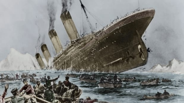 painting of the Titanic just as it's going under, with lifeboats in the foreground