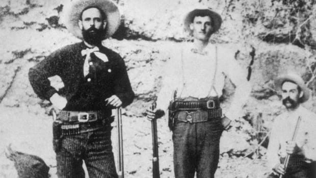 Wild West Outlaw Jesse James with members of his gang, probably two of the Younger brothers.
