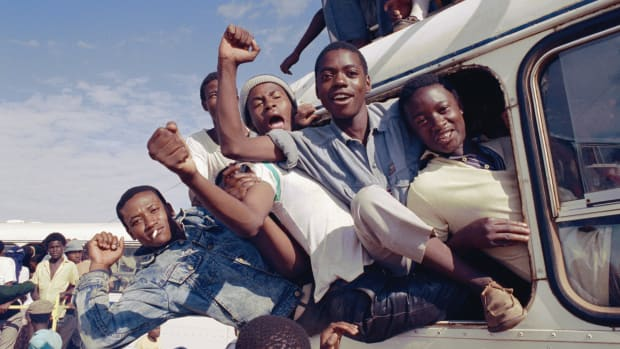 Key Steps That Led to End of Apartheid; South African men cheer and celebrate the news of Nelson Mandela's release from prison, 1990