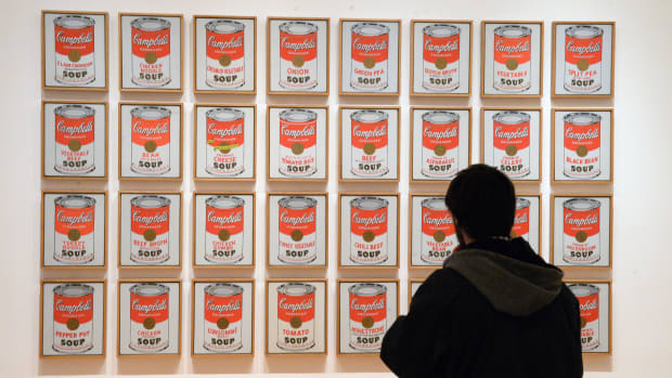 A visitor looks at the work 'Campbell's Soup Cans' by artist Andy Warhol at the Museum of Modern Art (MoMA) in New York City