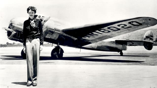 Amelia Earhart, pictured with the Lockheed Electra in which she disappeared in 1937.