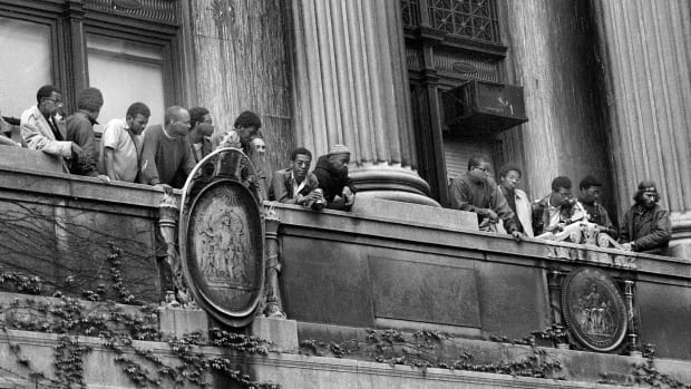 Columbia University Protest, 1968. African American students look down on the balcony of Hamilton Hall at Columbia University during student demonstrations
