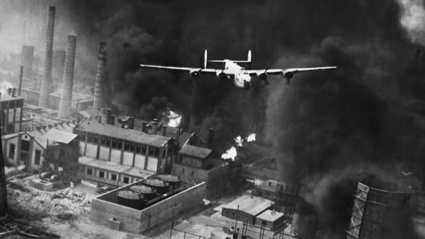 A plane from the 9th U.S. Army Air Force flying over Ploesti, Romania during an air attack on gasoline tanks
