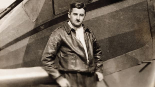 William Faulkner, pictured next to a plane circa 1930