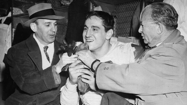 Lou Groza (center) hugs the shoe he used to kick the winning field in the 1950 NFL Championship Game