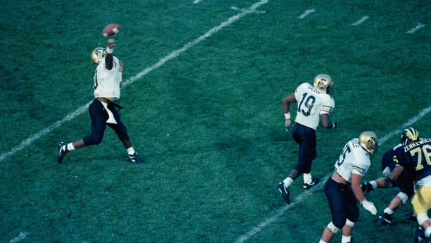 Colorado quarterback Kordell Stewart lets go of the ball for a 64-yard game-winning touchdown to teammate Michael Westbrook against Michigan, Saturday, September 24, 1994. Colorado beat Michigan 27-26. (AP Photo/Jon Freilich)