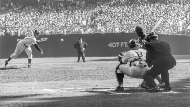 Pitcher Don Larson of the New York Yankees delivers the first pitch to Jim Gilliam of the Brooklyn Dodgers as catcher Yogi Berra and umpire Babe Pinelli look on during Game 5 of the 1956 World Series on October 8, 1956 at Yankee Stadium. Larson would go on to pitch a perfect game against the Dodgers. (Photo by Stanley Weston/Getty Images)