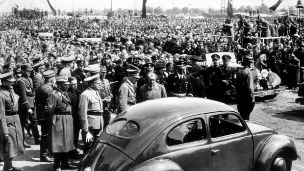 May 26, 1938: German Chancellor and Nazi dictator Adolf Hitler inspects the new 'People's Car' at Volkswagen factory in Fallersleben, Germany, designed to manufacture 6 million of the cars.