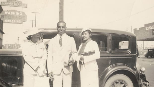 Customers stand outside Berry's Service Station in Tulsa.