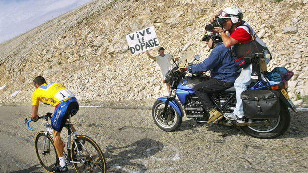 Lance Armstrong climbing the Mont Ventoux next to a banner against doping during the 14th stage of the 89th Tour de France between Lodeve and the Mont Ventoux, 21 July 2002