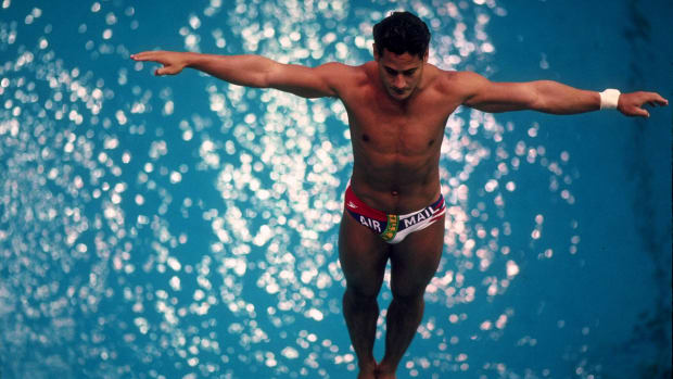 Greg Louganis of the USA sets his feet on the edge of the diving board before attempting a dive in the men's spring board competition during the 1988 Summer Olympic Games held in Seoul, South Korea.