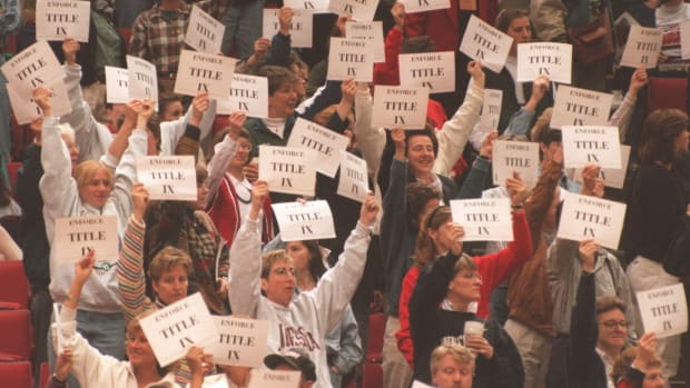 Members and supporters of the Women's Basketball Coaches Association demonstrated several times during the two semifinal games of the Women's Final Four at Target Center in support of Title IX by holding up signs in the stands.