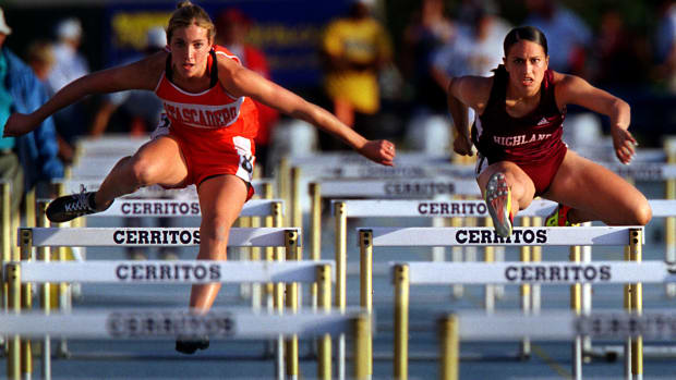 Gina Londono, right, of Highland, makes her way to a third place (15.42) finish in the women's 100–meter high hurdlesduring the CIF Southern Section Track and Field Masters Meet held Friday evening iat Cerritos College.