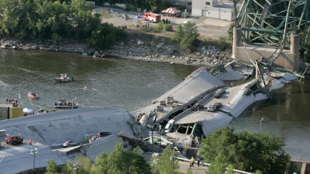 August 3, 2007. Minneapolis, Minnesota. Investigators move cautiously amid the rubble of the 35W bridge that lies in pieces in the Mississippi River.