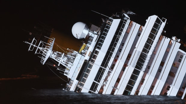 Night view on January 16, 2012, of the cruise liner Costa Concordia aground in front of the harbor of Isola del Giglio after hitting underwater rocks on January 13.