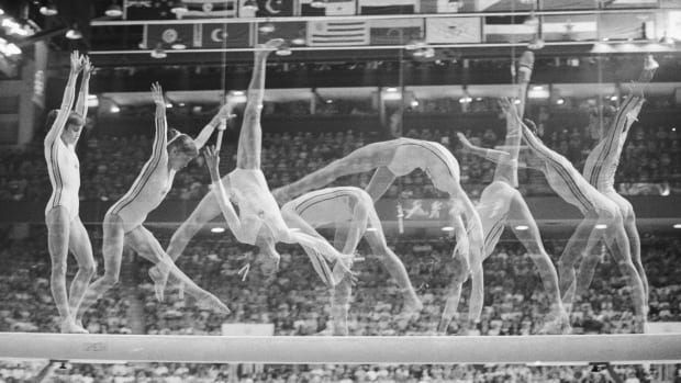 Romania's Nadia Comaneci on the balance beam at the Summer Olympics in 1976.