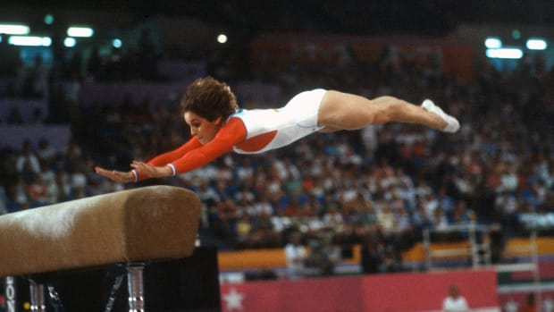LOS ANGELES, CA - CIRCA 1984: Gymnast Mary Lou Retton of the United States competes in the vault competition in gymnastics during the Games of the XXIII Olympiad in the 1984 Summer Olympics circa 1984 at UCLA's Pauley Pavilion in Los Angeles, California. (Photo by Focus on Sport/Getty Images)