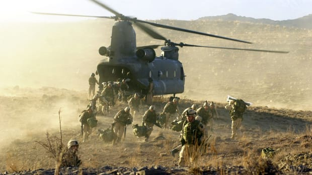 U.S. Army soldiers from the 101st Airborne division off load during a combat mission from a Chinook 47 helicopter March 5, 2002 in Eastern Afghanistan. The soldiers were participating in the largest American offensive since the beginning of the war in Afghanistan.